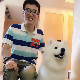 Sihe and his fluffy white dog